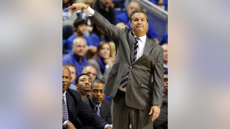 Kentucky head coach John Calipari directs his team during the first half of an NCAA college basketball game against Northern Kentucky, Sunday, Nov. 10, 2013, in Lexington, Ky. (AP Photo/James Crisp)