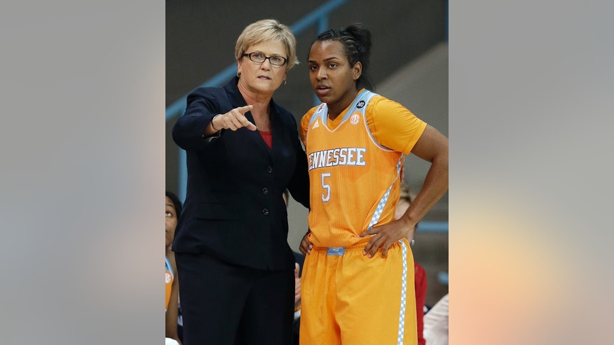 Tennessee's Ariel Massengale (5) speaks with head coach Holly Warlick (5) during the first half of an NCAA college basketball game in Chapel Hill, N.C., Monday, Nov. 11, 2013. (AP Photo/Gerry Broome)