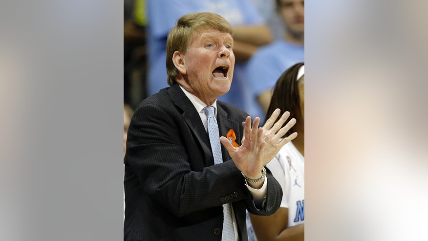 North Carolina associate coach Andrew Calder directs his team against Tennessee during the first half of an NCAA college basketball game in Chapel Hill, N.C., Monday, Nov. 11, 2013. Head coach Sylvia Hatchell is out while being treated for leukemia. (AP Photo/Gerry Broome)