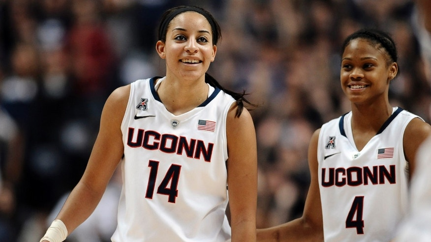 Connecticut's Bria Hartley and Moriah Jefferson smile during the second half of an NCAA college basketball game, Monday, Nov. 11, 2013, in Storrs, Conn. Connecticut won 76-57. (AP Photo/Jessica Hill)