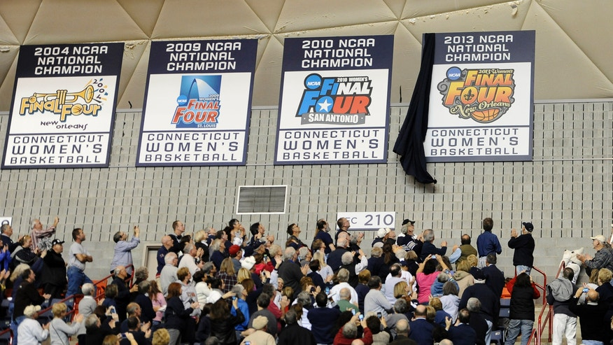 Fans react as Connecticut's championship banner is revealed at Gampel Pavilion prior to an NCAA college basketball game against Stanford, Monday, Nov. 11, 2013, in Storrs, Conn. (AP Photo/Jessica Hill)