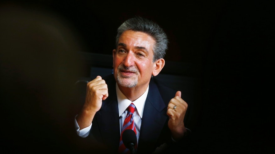 Washington Wizards basketball and Washington Capitols hockey teams owner Ted Leonsis gestures during an interview with The Associated Press in Washington, Tuesday, Nov. 12, 2013.  Leonsis said he doesn't ask for much from the District of Columbia government _ but he says better traffic control and increased security around Verizon Center would be nice. Leonsis spoke to Associated Press reporters and editors on Tuesday. He praised the city government and the administration of Mayor Vincent Gray, saying the city has never been friendlier to business.  (AP Photo/Charles Dharapak)