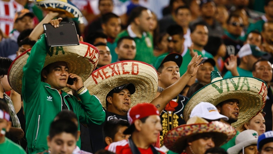 EAST RUTHERFORD, NJ - AUGUST 14:  Fans of Mexico cheer during their match against Ivory Coast at MetLife Stadium on August 14, 2013 in East Rutherford, New Jersey.  (Photo by Jeff Zelevansky/Getty Images)