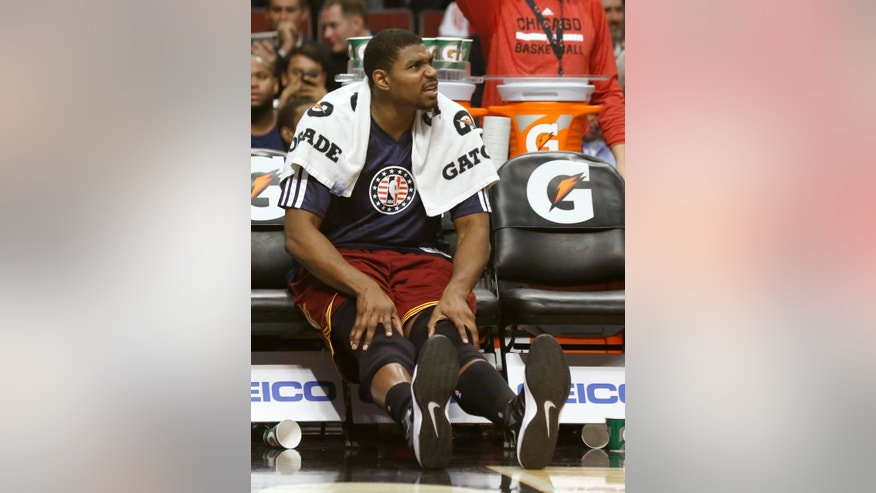 Cleveland Cavaliers center Andrew Bynum sits on the bench during the second half of an NBA basketball game against the Chicago Bulls Monday, Nov. 11, 2013, in Chicago. The Bulls won 96-81. (AP Photo/Charles Rex Arbogast)