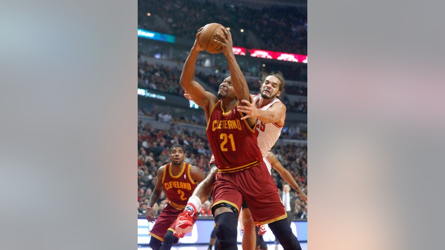 Cleveland Cavaliers center Andrew Bynum (21) scores past Chicago Bulls center Joakim Noah, who fouled Bynum on the play, during the first half of an NBA basketball game Monday, Nov. 11, 2013, in Chicago. (AP Photo/Charles Rex Arbogast)