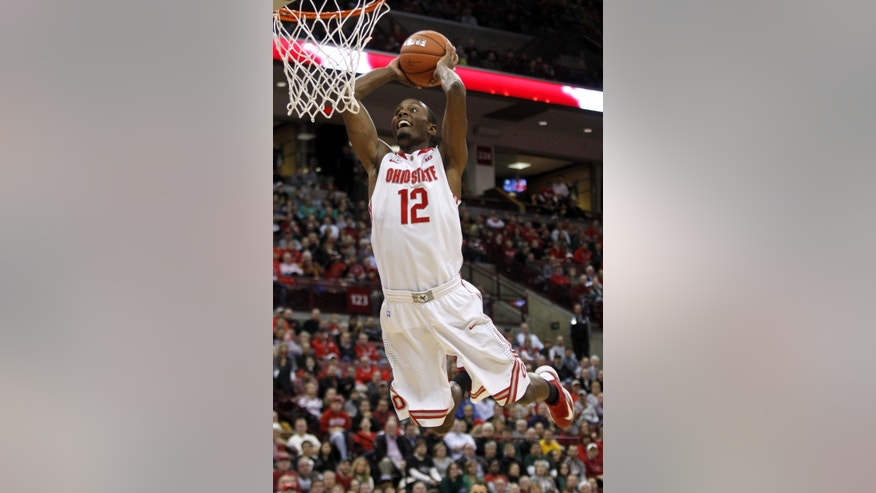 Ohio State's Sam Thompson (12) goes up for a dunk against Ohio during the first half of an NCAA college basketball game in Columbus, Ohio, Tuesday, Nov. 12, 2013. (AP Photo/Paul Vernon)