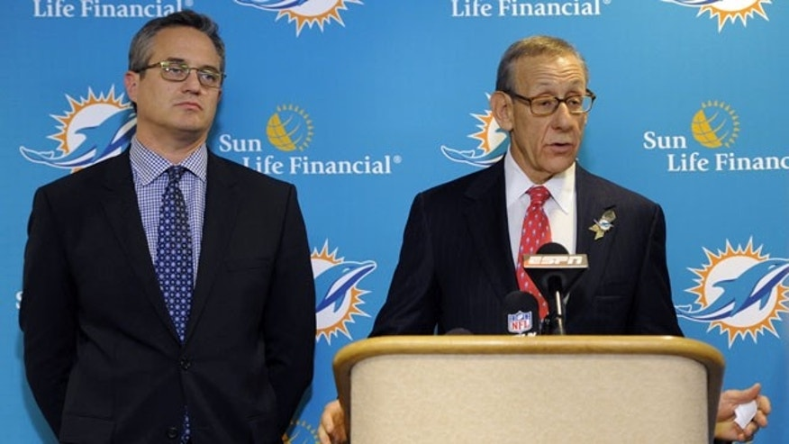 November 11,2013: Miami Dolphins owner Stephen Ross, right, and CEO Tom Garfinkel address the media before an NFL football game against the Tampa Bay Buccaneers Monday, Nov. 11, 2013, in Tampa, Fla. (AP Photo/Brian Blanco)