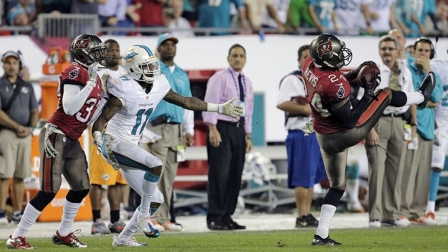November 11, 2013: Tampa Bay Buccaneers cornerback Darrelle Revis (24) intercepts a pass intended for Miami Dolphins wide receiver Mike Wallace (11) during the fourth quarter of an NFL football game. (AP Photo)