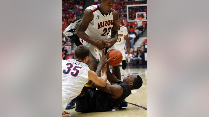Arizona's Rodnae Hollis-Jefferson (23) and Kaleb Tarczewski (35) struggle with Long Beach State's Nick Shepherd, on floor, for control of a loose ball in the first half of an NCAA of an college basketball game, Monday, Nov. 11, 2013 in Tucson, Ariz. (AP Photo/John Miller)
