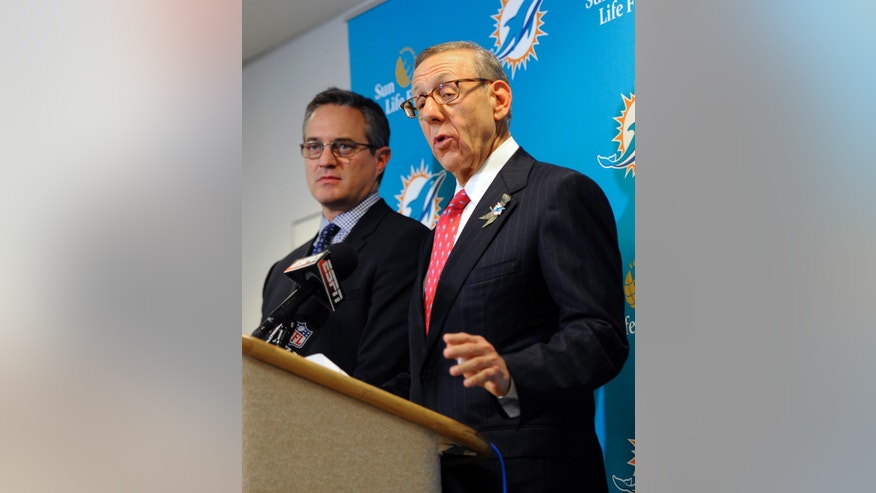 Miami Dolphins owner Stephen Ross, right, and CEO Tom Garfinkel address the media before an NFL football game against the Tampa Bay Buccaneers Monday, Nov. 11, 2013, in Tampa, Fla. (AP Photo/Brian Blanco)