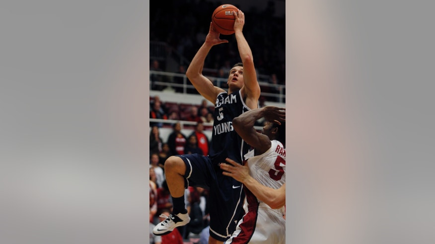 Brigham Young's  Kyle Collinsworth shoots over Stanford's Chasson Randle during the first half of an NCAA college basketball game, Monday, Nov. 11, 2013, in Stanford, Calif.  (AP Photo/George Nikitin)