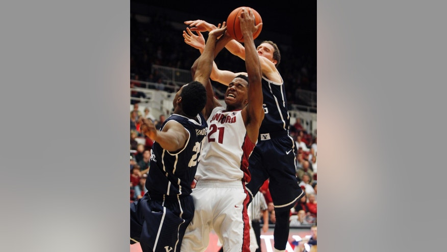 Stanford's Anthony Brown, center, shoots, as Brigham Young's Anson Winder, left, and Skyler Halford guard during the first half of an NCAA college basketball game, Monday, Nov. 11, 2013, in Stanford, Calif.  (AP Photo/George Nikitin)