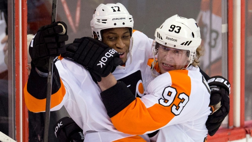 Philadelphia Flyers right wing Jakub Voracek, right, celebrates his second goal of the period with teammate Wayne Simmonds during the second period of an NHL hockey game Tuesday, Nov. 12, 2013, in Ottawa, Ontario. (AP Photo/The Canadian Press, Adrian Wyld)