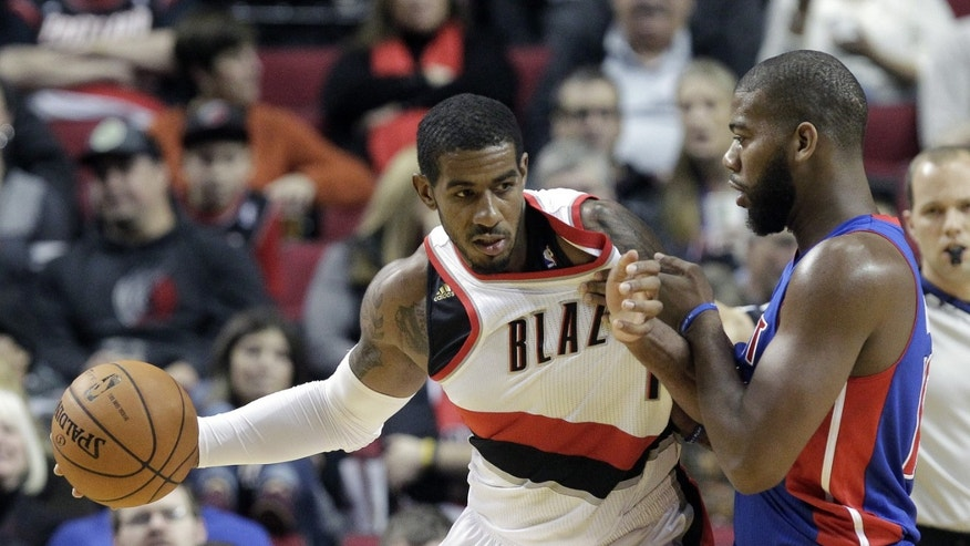 Portland Trail Blazers forward LaMarcus Aldridge, left, backs in on Detroit Pistons forward Greg Monroe during the first half of an NBA basketball game in Portland, Ore., Monday, Nov. 11, 2013. (AP Photo/Don Ryan)
