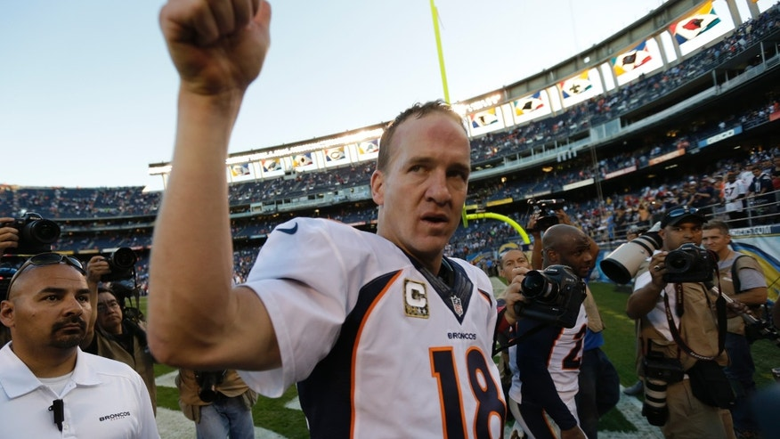 Denver Broncos quarterback Peyton Manning gestures towards fans after beating the San Diego Chargers in an NFL football game Sunday, Nov. 10, 2013, in San Diego. The Broncos won, 28-20. (AP Photo/Gregory Bull)