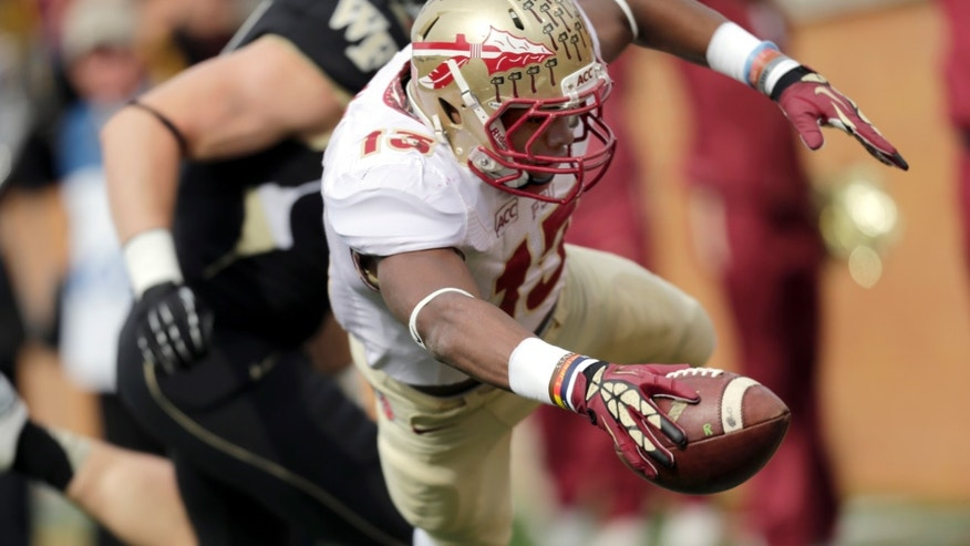 Florida State defensive back Jalen Ramsey dives into the end zone to score after an interception against Wake Forest in the first half of an NCAA college football game in Winston-Salem, N.C., Saturday, Nov. 9, 2013. (AP Photo/Nell Redmond)