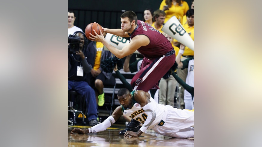 South Carolina Laimonas Chatkevicius (14) pulls down a rebound over Baylor's Cory Jefferson (34) in the first half of an NCAA college basketball game, Tuesday, Nov. 12, 2013, in Waco, Texas. (AP Photo/Waco Tribune Herald, Rod Aydelotte)