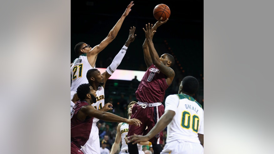 South Carolina's Sindarius Thornwell (0), right, shoots over Cory Jefferson (34) and Issiah Austin (21), left, in the first half of an NCAA college basketball game, Tuesday, Nov. 12, 2013, in Waco, Texas. (AP Photo/Waco Tribune Herald, Rod Aydelotte)