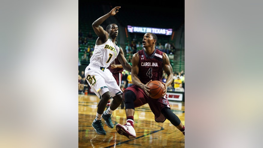 South Carolina's Tyrone Johnson (4), right, drives on Baylor's Kenny Chery (1), left, in the first half of an NCAA college basketball game, Tuesday, Nov. 12, 2013, in Waco, Texas. (AP Photo/Waco Tribune Herald, Rod Aydelotte)