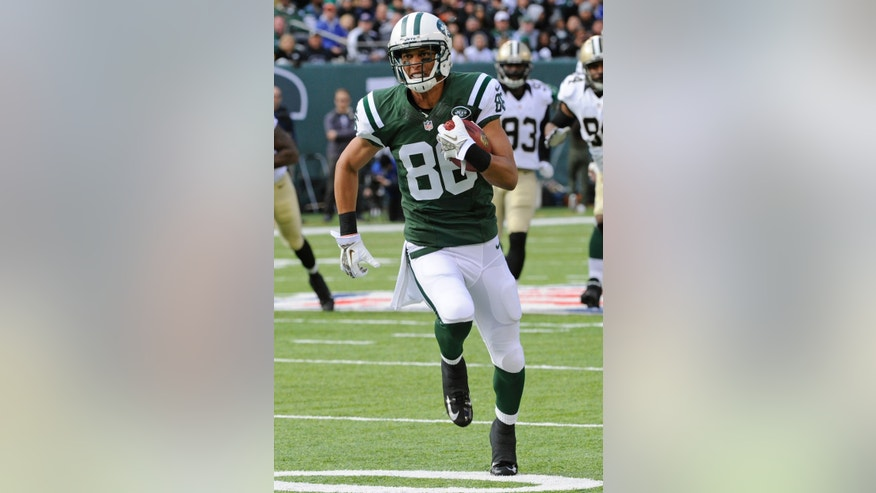 "FILE - In this Nov. 3, 2013, file photo, New York Jets wide receiver David Nelson runs during the first half of an NFL football game against the New Orleans Saints, in East Rutherford, N.J.  Nelson has been mad at the Buffalo Bills for months. Since Feb. 24, to be exact. That's when the Jets wide receiver heard that the Bills elected not to tender him, a restricted free agent, a contract offer. His three-year career with Buffalo was over _ and it was the way he got the news that riled him up.""I found out through Twitter,"" Nelson recalled Monday, Nov. 11, 2013, ""like a lot of other things in life."" (AP Photo/Bill Kostroun, File)"