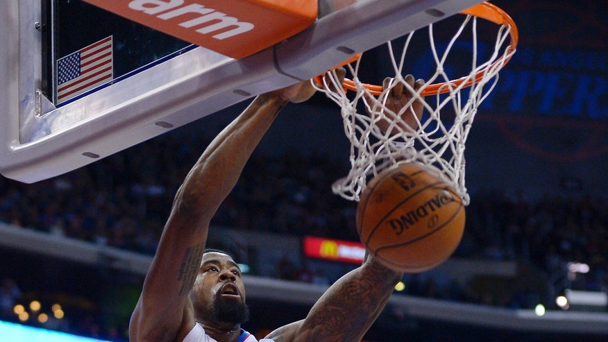 Los Angeles Clippers center DeAndre Jordan dunks during the first half of an NBA basketball game against the Minnesota Timberwolves, Monday, Nov. 11, 2013, in Los Angeles. (AP Photo/Mark J. Terrill)
