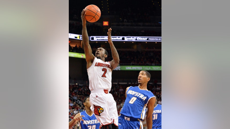 Louisville's Russ Smith, left, goes in for a layup around the defense of Hofstra's Jordan Allen during the second half of an NCAA college basketball game Tuesday, Nov. 12, 2013, in Louisville, Ky. Louisville won 97-69. (AP Photo/Timothy D. Easley)