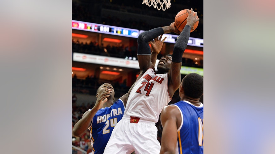 Louisville's Montrezl Harrell, center, goes up for a shot past the defense of Hofstra's Stephen Nwaukoni, left, during the second half of an NCAA college basketball game Tuesday, Nov. 12, 2013, in Louisville, Ky. Louisville won 97-69. (AP Photo/Timothy D. Easley)