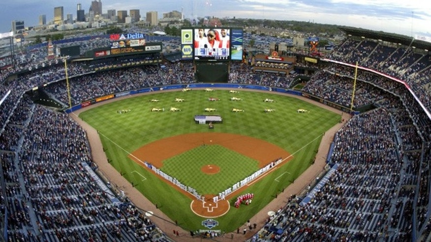 In this April 8, 2005 file photo, The Atlanta Braves, right, and the New York Mets stand on the baselines at Turner Field in Atlanta during opening day ceremonies.