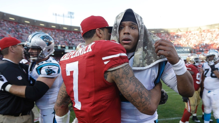 San Francisco 49ers quarterback Colin Kaepernick (7) hugs Carolina Panthers quarterback Cam Newton after an NFL football game in San Francisco, Sunday, Nov. 10, 2013. (AP Photo/Marcio Jose Sanchez)