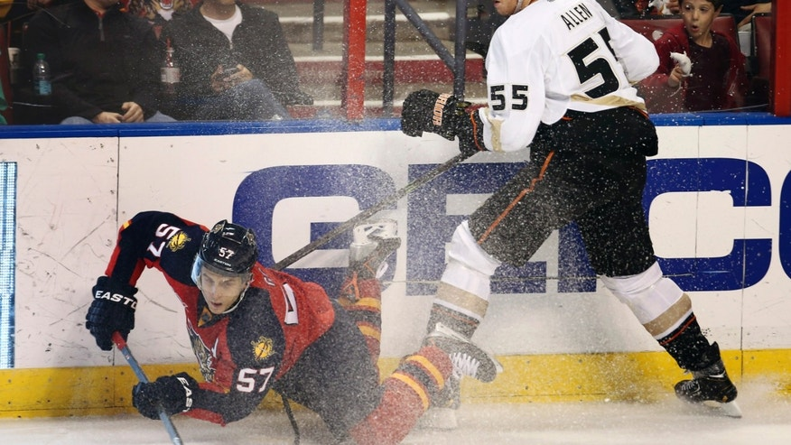 Anaheim Ducks' Bryan Allen (55) watches as Florida Panthers' Marcel Goc (57) goes for the puck during the second period of an NHL hockey game in Sunrise, Fla., Tuesday, Nov. 12, 2013. (AP Photo/J Pat Carter)