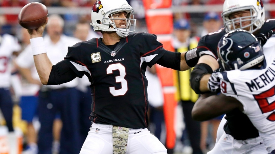 Arizona Cardinals quarterback Carson Palmer (3) throws during the first half of an NFL football game as Houston Texans outside linebacker Whitney Mercilus pursues Sunday, Nov. 10, 2013, in Glendale, Ariz. (AP Photo/Ross D. Franklin)