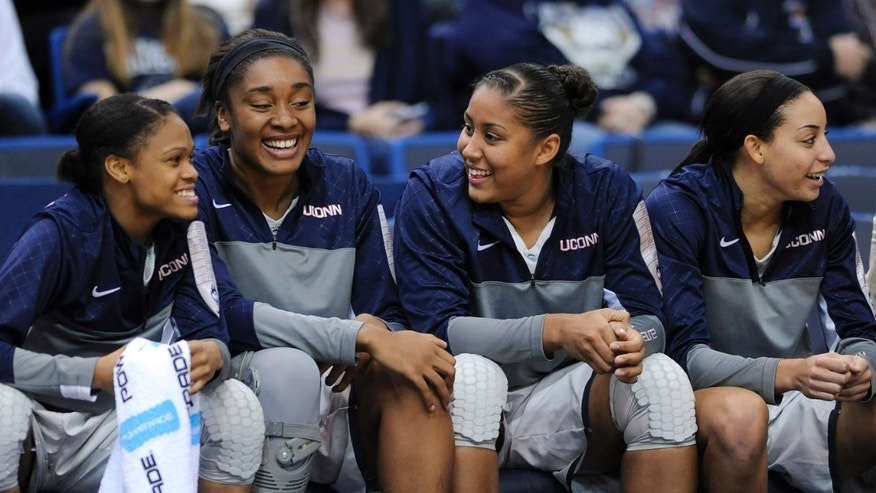 Connecticut's Moriah Jefferson, Kaleena Mosqueda-Lewis, Morgan Tuck and Bria Hartley, from left, enjoy a moment near the end of the second half of an NCAA college basketball game, in Hartford, Conn., on Saturday, Nov. 9, 2013. Jefferson scored a game-high 17 points in Connecticut's 89-34 victory. (AP Photo/Fred Beckham)