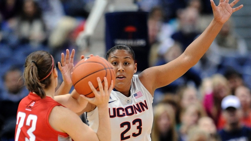 Connecticut forward Kaleena Mosqueda-Lewis, right, guards Hartford guard Alyssa Englert during the first half of an NCAA college basketball game in Hartford, Conn., on Saturday, Nov. 9, 2013. (AP Photo/Fred Beckham)