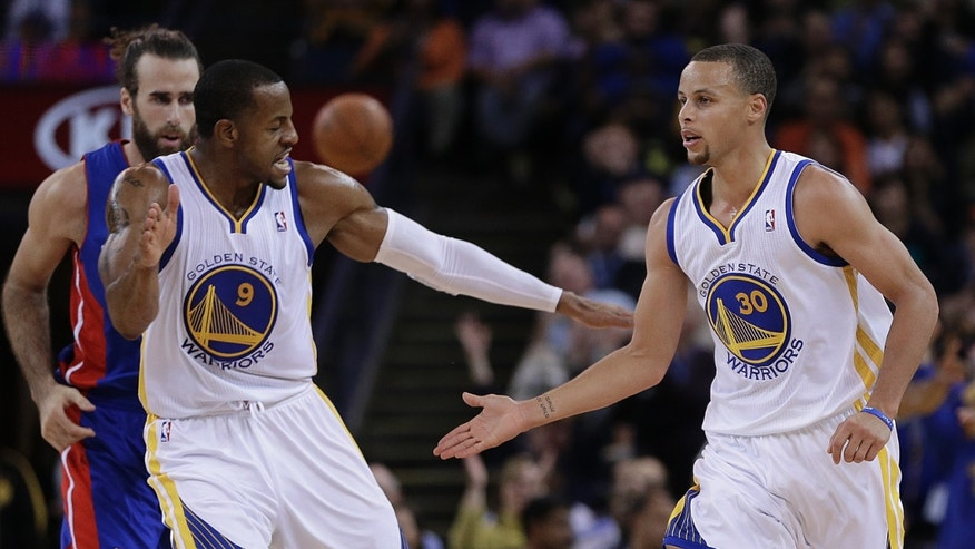 Golden State Warriors' Andre Iguodala (9) and Stephen Curry, right, celebrate a score by Curry against the Detroit Pistons during the second half of an NBA basketball game Tuesday, Nov. 12, 2013, in Oakland, Calif. (AP Photo/Ben Margot)