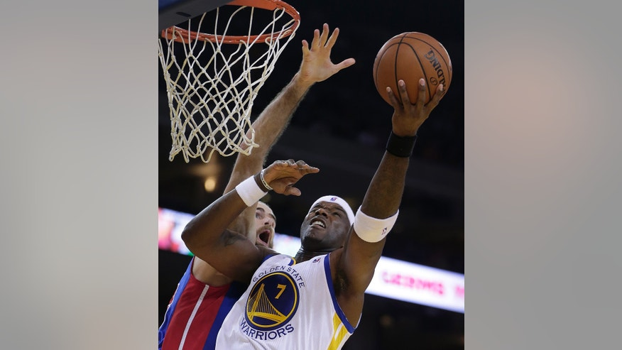 Golden State Warriors' Jermaine O'Neal, right, lays up a shot over Detroit Pistons' Luigi Datome during the second half of an NBA basketball game Tuesday, Nov. 12, 2013, in Oakland, Calif. (AP Photo/Ben Margot)