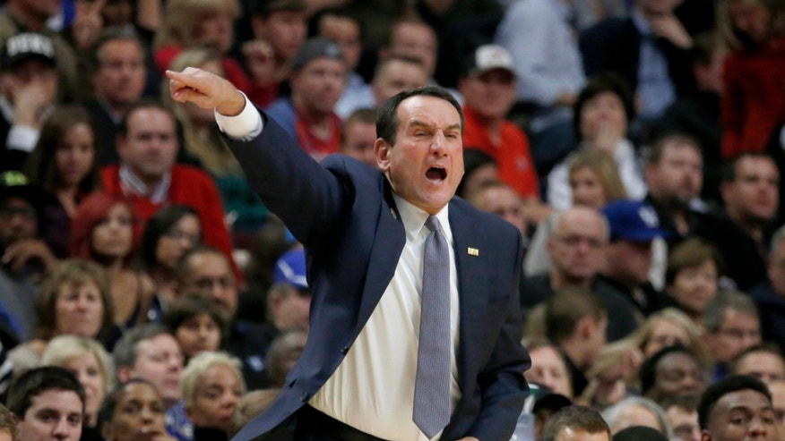 Duke coach Mike Krzyzewski yells to his team during the first half of an NCAA college basketball game against Kansas Tuesday, Nov. 12, 2013, in Chicago. (AP Photo/Charles Rex Arbogast)