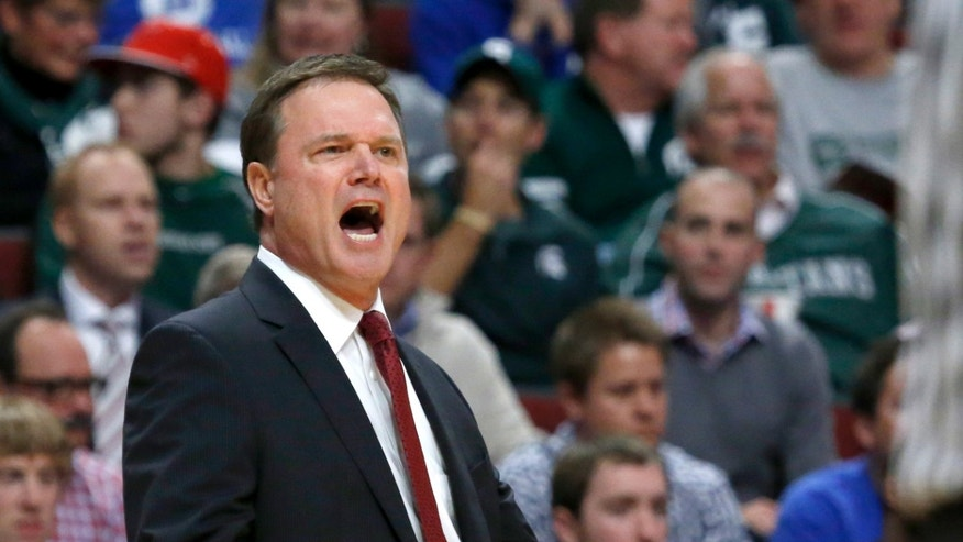 Kansas coach Bill Self yells at his team during the first half of an NCAA college basketball game against Duke, Tuesday, Nov. 12, 2013, in Chicago. (AP Photo/Charles Rex Arbogast)