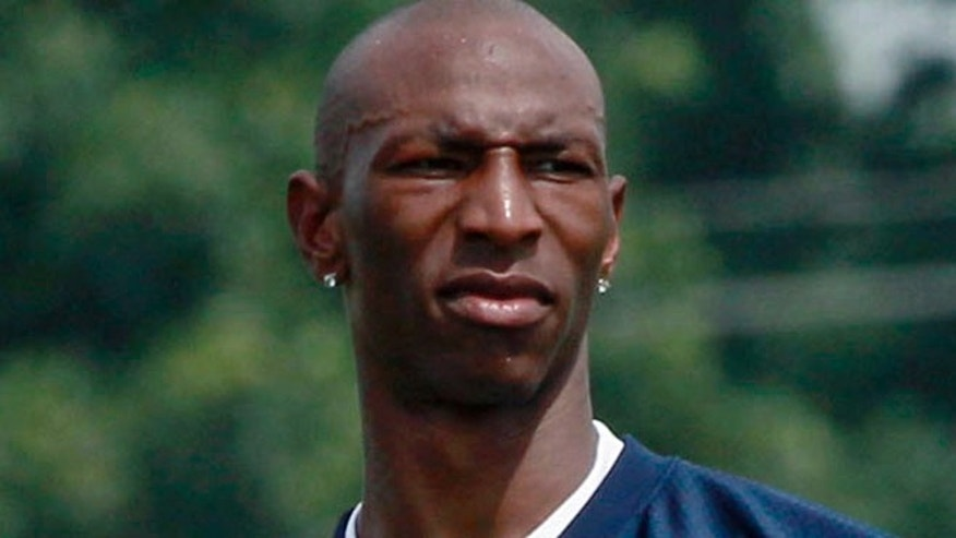 Aug. 2, 2011: Chicago Bears wide receiver Sam Hurd watches teammates practice during NFL football training camp at Olivet Nazarene University in Bourbonnais, Ill.