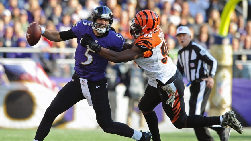 Baltimore Ravens quarterback Joe Flacco is sacked by Cincinnati Bengals defensive end Carlos Dunlap during the first half of a NFL football game in Baltimore, Sunday, Nov. 10, 2013. (AP Photo/Gail Burton)