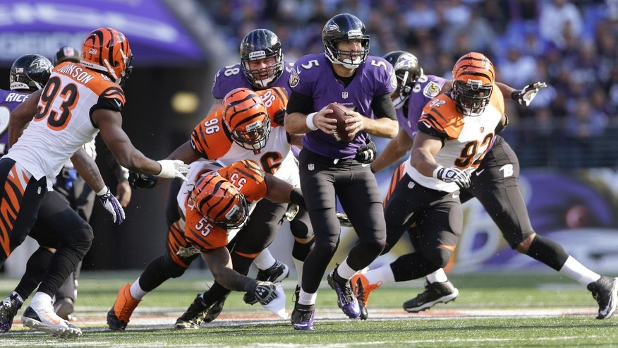 Baltimore Ravens quarterback Joe Flacco scrambles put of trouble as (L-R) Cincinnati Bengals defensive end Michael Johnson, outside linebacker Vontaze Burfict, defensive end Carlos Dunlap and outside linebacker James Harrison close in during the first half of a NFL football game against the Cincinnati Bengals in Baltimore, Sunday, Nov. 10, 2013. (AP Photo/Patrick Semansky)