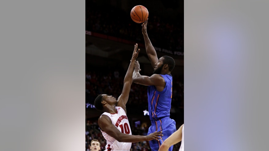 Florida's Patric Young, right, shoots past Wisconsin's Nigel Hayes during the first half of an NCAA college basketball game Tuesday, Nov. 12, 2013, in Madison, Wis. (AP Photo/Andy Manis)