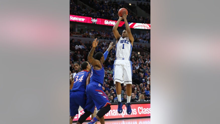 Duke forward Jabari Parker (1) shoots over Kansas forward Perry Ellis (34) and Tarik Black during the first half of an NCAA college basketball game on Tuesday, Nov. 12, 2013, in Chicago. (AP Photo/Charles Rex Arbogast)