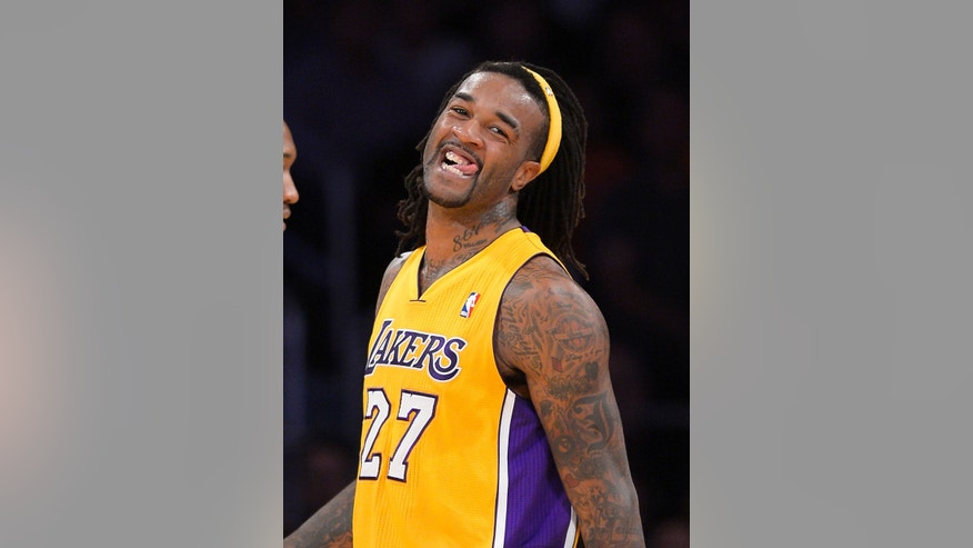 Los Angeles Lakers center Jordan Hill smiles after scoring during the first half of an NBA basketball game against the New Orleans Pelicans, Tuesday, Nov. 12, 2013, in Los Angeles. (AP Photo/Mark J. Terrill)