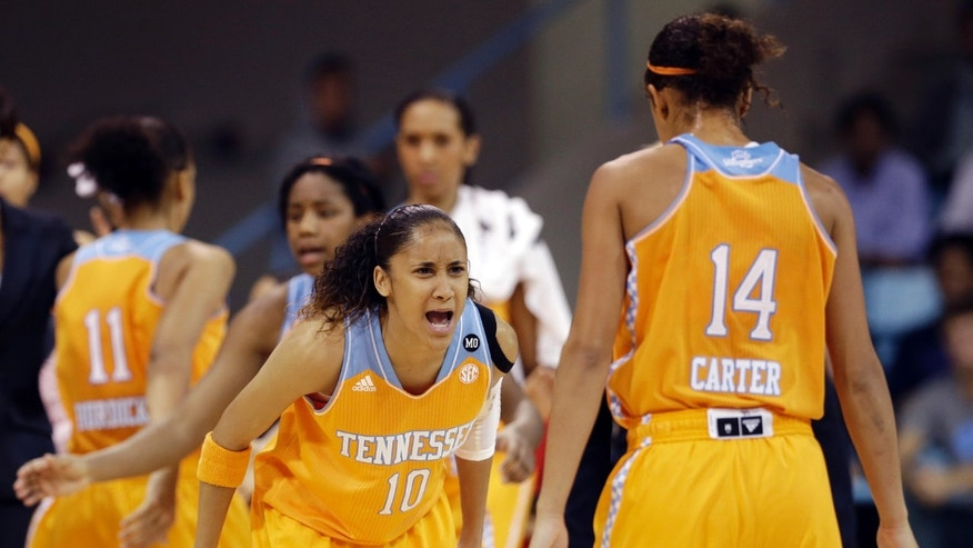 Tennessee's Meighan Simmons (10) and Andraya Carter (14) react following a play against North Carolina during the first half of an NCAA college basketball game in Chapel Hill, N.C., Monday, Nov. 11, 2013. Tennessee won 81-65. (AP Photo/Gerry Broome)