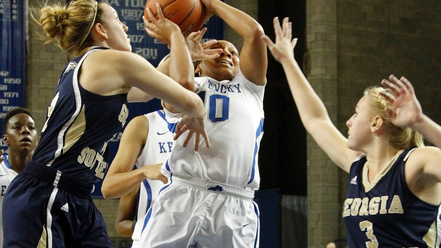 Kentucky's Bernisha Pinkett shoots between Georgia Southern's MiMi DuBose, left, and Danielle Roberts (3) during the second half of an NCAA college basketball game, Wednesday, Nov. 13, 2013, in Lexington, Ky. Kentucky won 103-38. (AP Photo/James Crisp)