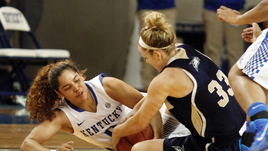 Kentucky's Jennifer O'Neill, left, and Georgia Southern's MiMi DuBose battle for a loose ball during the first half of an NCAA college basketball game, Wednesday, Nov. 13, 2013, in Lexington, Ky.  (AP Photo/James Crisp)