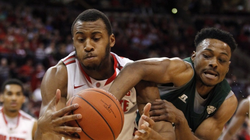 Ohio State's Trey McDonald, left, and Ohio's T.J. Hall go for a rebound during the first half of an NCAA college basketball game in Columbus, Ohio, Tuesday, Nov. 12, 2013. (AP Photo/Paul Vernon)