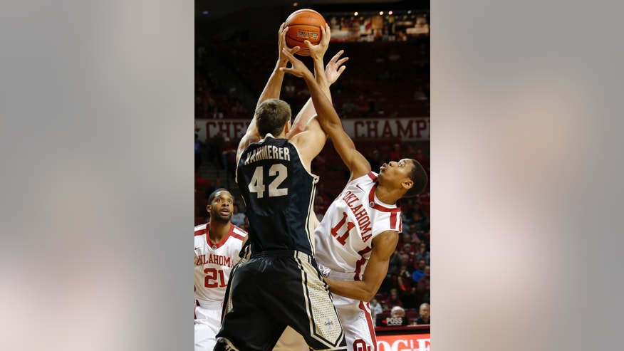 Oklahoma's Isaiah Cousins (11) defends against Idaho's Joe Kammerer (42) as Oklahoma's Cameron Clark (21) watches during an NCAA college basketball game in Norman, Okla., Wednesday, Nov. 13, 2013.  (AP Photo/The Oklahoman, Bryan Terry) LOCAL TV OUT (KFOR,KOCO,KWTV,KOKH, KAUT OUT); LOCAL INTERNET OUT; LOCAL PRINT OUT (EDMOND SUN, NORMAN TRANSCRIPT, OKLAHOMA GAZETTE, SHAWNEE NEWS-STAR THE JOURNAL RECORD OUT); TABLOIDS OUT