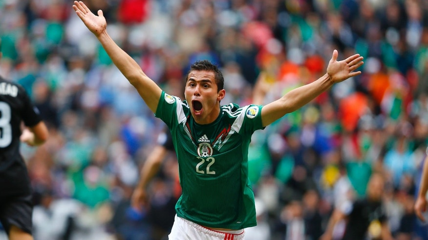 Mexico's Paul Aguilar reacts after his goal was annulled during a 2014 World Cup playoff first round soccer match against New Zealand in Mexico City, Wednesday, Nov. 13, 2013. Aguilar later scored again. (AP Photo/Christian Palma)