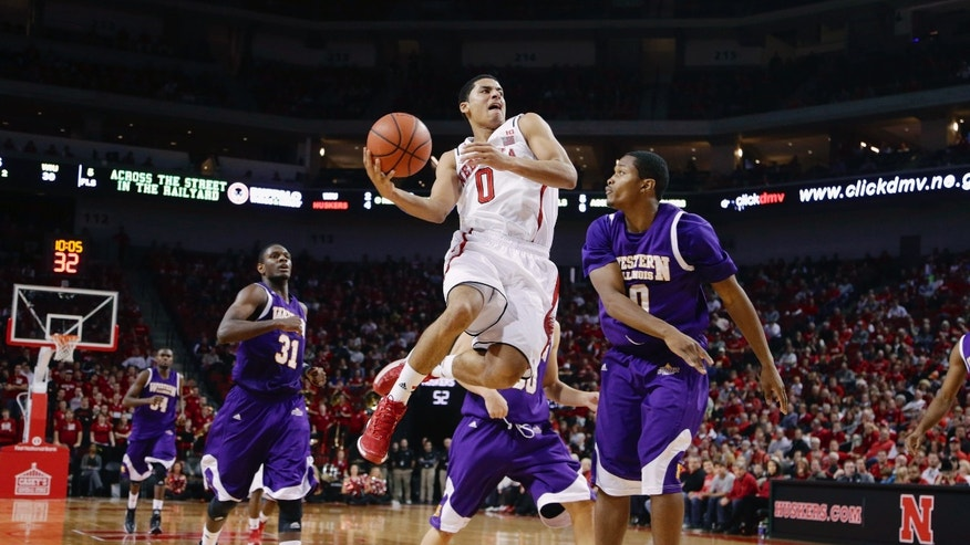 Nebraska guard Tai Webster (0) goes for a basket against Western Illinois guard Jordan Foster, right, and Garret Covington (31) in the second half of an NCAA college basketball game in Lincoln, Neb., Tuesday, Nov. 12, 2013. (AP Photo/Nati Harnik)